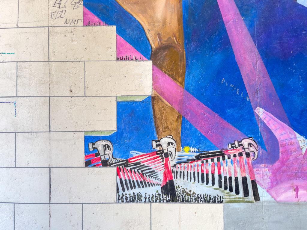 Dessin de l'album The Wall de Pink Floyd sur le mur de Berlin